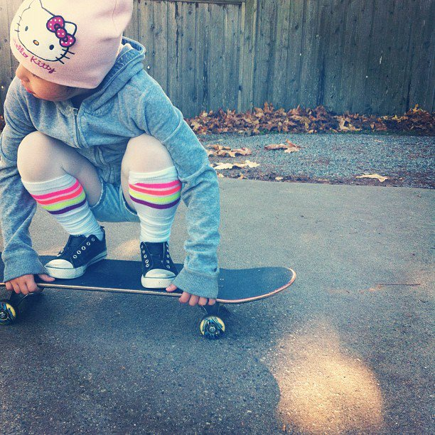 white with colorful stripe socks Hello Kitty Fan Skating Around with Knee High Socks